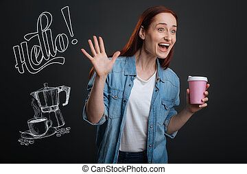 Expressive woman feeling exited while noticing her friend in a cafe