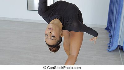 Expressive woman in motion of dance