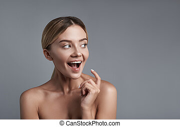 Expressive woman looking happy and opening her mouth -...