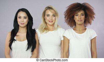 Expressive women posing in studio - Portrait of three...