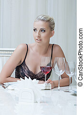Expressive young blonde posing in restaurant