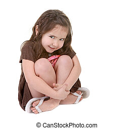 Expressive Young Child Hugging Her Legs