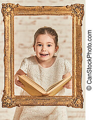 Expressive young little girl reading a book