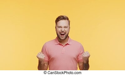 Expressive young man over vibrant background. Studio ...