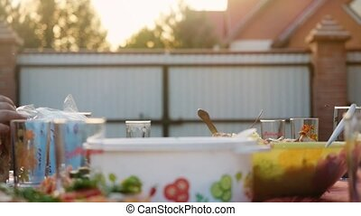 Exquisitely decorated table with delicious meat, salads and wine for Romantic dinner in the village outdoor in slowmotion. 1920x1080