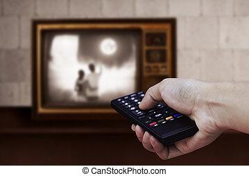 extérieur tv, tenant main