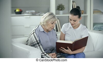 Extended Care - Senior patient reading a book with medical...