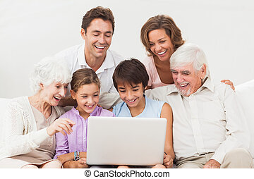 Extended family looking at laptop - Extended family all...