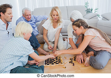 Extended family playing chess