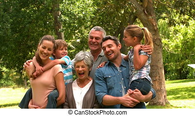 Extended family posing in the park