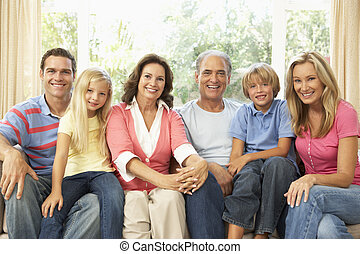Extended Family Relaxing At Home Together