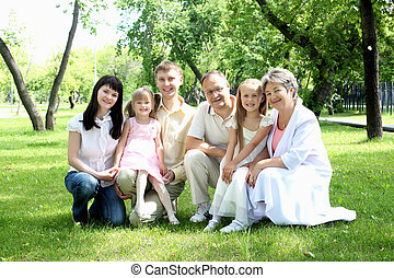 Extended family together in the park