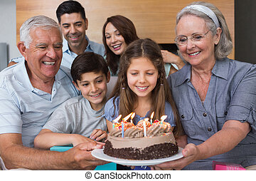 Extended family with cake in the li