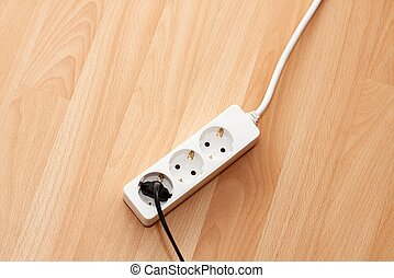 Electric extension cable on the floor