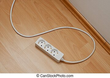 Extension cord - White extension cord on the parquet floor