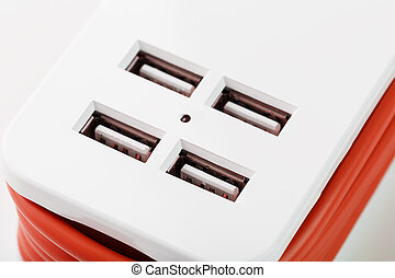 Extension Socket with USB Port on white background for charging phones and electronic devices, red power cord.