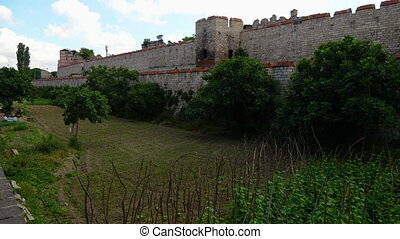 Extensive Theodosian Walls of Constantinople with a grassy...