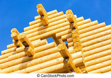 exterior frame of a log home under construction.