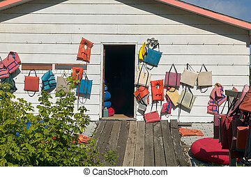 Exterior of a wooden clubhouse or store displaying life...