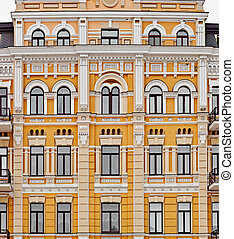 Exterior of european yellow building with many windows, neoclassic architecture