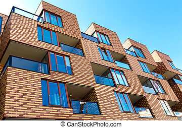 Exterior of new apartment buildings on a blue sky background.