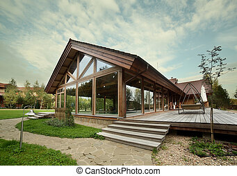exterior of wooden house with swimming pool