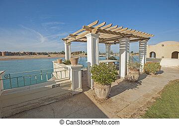 Exterior outdoor dining area of luxury tropical villa