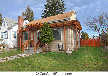 Exterior photo of small beige house