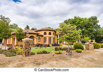 Exterior view of a large house located on the hills of Saratoga, south San Francisco bay area, California