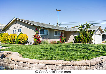 Exterior view of single-family detached home on a corner lot in a residential neighborhood; South San Francisco Bay Area, California