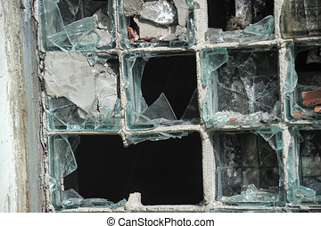 Exterior with broken windows of an old industrial building