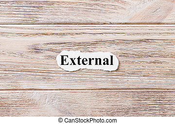 EXTERNAL of the word on paper. concept. Words of EXTERNAL on a wooden background