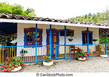 external view of a traditional house in the mountains of Colombia, coffee cultural landscape, bio-construction, friendly to the environment. Travel destinations.