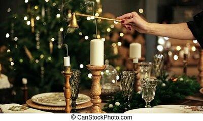 Extinguish two candles fire with extinguisher. Merry christmas decor background. Put out the candles