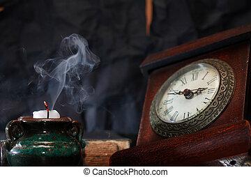 Extinguished Candle Near Clock