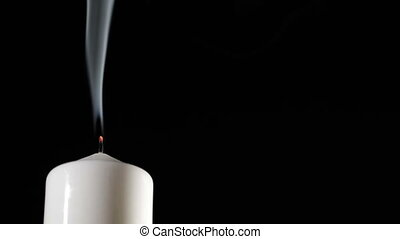 Extinguished candle with beautiful dancing smoke.