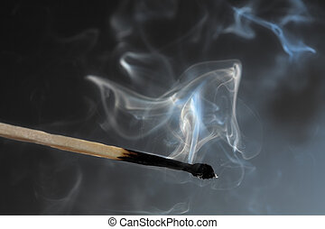 Photo of smoldering match that has just been extinguished.