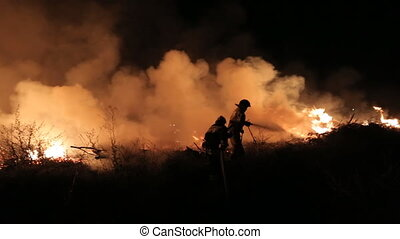 Extinguishing of a huge fire in the forest at night
