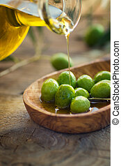 Olive oil - Extra virgin healthy Olive oil with fresh olives...