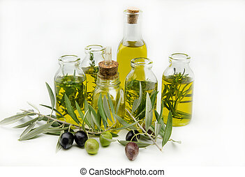 Extra virgin olive oil surrounded by freshly harvested ...