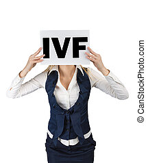 Extracorporal fertilization. Word IVF on a sheet of paper in the hands of women.