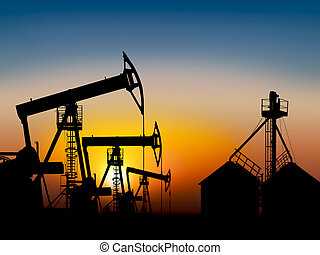 oil field at sunset near the storage tank - extracting ...