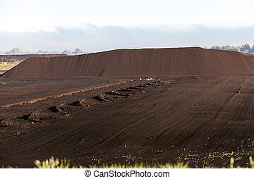 bog and the field on which the production is carried out in black peat mining, industry,