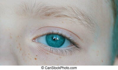 Extraordinarily beautiful turquoise eyes of teenage boy with...