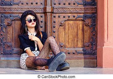 extraordinary girl posing on the ground