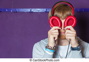 Funny looking man with headphone eyes
