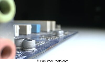 Extreme close-up, detailed. motherboard with multi-colored inputs.