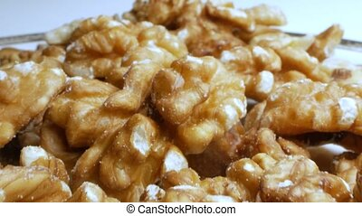extreme close-up, detailed. pile of peeled walnut kernels.