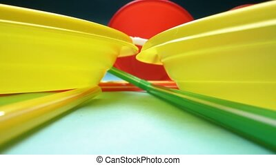 close-up, detailed. set of multicolored plastic dishes on a blue background