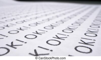 extreme close-up, detailed. text background. the word ok written many times on a white piece of paper.